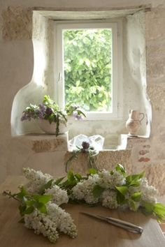 White Lilacs, and at the window is the remnants of a traditional stone sink, often sympathetically restored and part of the decor.
