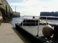 walking towards the speedboat
