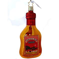 "Jamica Rum Christmas Ornament 1-171-13 Inge-Glas of Germany Size: 5.5"" Ht; 2.25"" width Orange/Copper colored bottle with paper label on front, outlined in glitter. Plain on back"