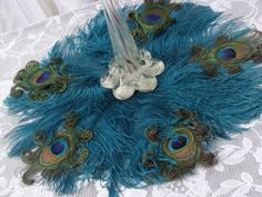 """Exquisite 16"""" Ostrich and Peacock Feather mat in your choice of colors  Love the cruly cues $30.00"""