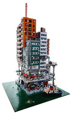 There's a whole city in this LEGO Modular MOC! This is something I absolutly love a LEGO modular Cyberpunk City MOC. Build and design by Shauppiluliumas Original post by lego storage legos castle blocks build custom cake table birthday party Lego City, Lego Modular, Lego Design, Lego Burg, Mega Pokemon, Amazing Lego Creations, Lego Worlds, Lego House, Toy House