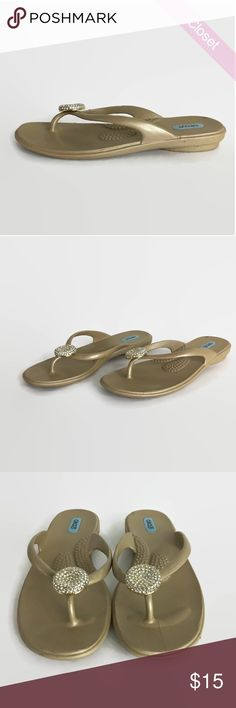 Eco Friendly Oka-B Lucky Flip Flop in Aged Gold M Gently Worn  Eco Friendly Oka-B Lucky Flip Flop in Aged Gold   Designed for comfort and therapeutic qualities that provides stability on wet and dry terrain. Machine washable and easy to sanitize and fade-resistant. Thin straps with crystal medallion on toe post. Enhanced massage beads on footbed and provides arch support.  Fits 8.5 to 9.5 OKA b. Shoes Sandals