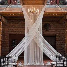 rustic wedding look: alter drapery, bistro lights, exposed brick (photo by IG: K. rustic wedding look: alter drapery, bistro lights, exposed brick (photo by IG: Kassie Ana Photography) STEP-BY-STEP INST. Wedding Draping, Wedding Ceremony Backdrop, Wedding Aisles, Diy Wedding Drapery, Wedding Table, Indoor Ceremony, Loft Wedding, Wedding Lighting, Wedding Reception