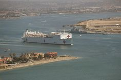 SAN DIEGO (June 16, 2014) The Military Sealift Command hospital ship USNS Mercy (T-AH 19) transits San Diego Bay as it departs for Rim of the Pacific (RIMPAC) 2014. Twenty-three nations, more than 40 ships and submarines, more than 200 aircraft and 25,000 personnel are participating in the biennial RIMPAC exercise from June 26 to Aug. 1. RIMPAC will take place in and around the Hawaiian Islands and San Diego. (U.S. Navy photo by Mass Communication Specialist 3rd Class Huey D. Younger Jr.)