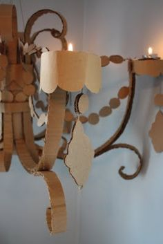 """Cardboard Chandelier""...maybe to go along with a cardboard coffee table?? lol :)"
