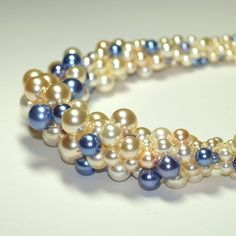 A new experiment in bead crochet for me...  a necklace made from faux pearls in all different sizes.  I'm really happy with the way it by esmeralda