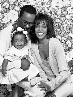 The Sweetest Houston-Brown Family Photos | FAMILY FIRST | Bobby Brown, Whitney Houston and daughter Bobbi Kristina Brown, 6 months, pose for a group shot on Sept. 1, 1993.