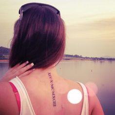 Roman numerals neck/spine tattoo