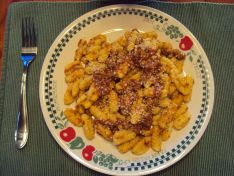Homemade Malloreddus in a simple marinara with Italian sausage, topped with grated cheese... from my blog, ALOHA!