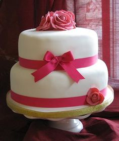 two tiered white wedding cake with red flowers - Google Search