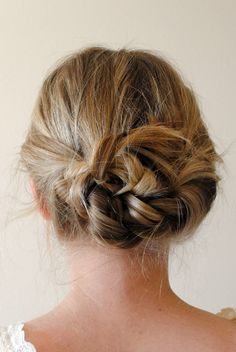 braid hair like putting it in pigtails, tie the braids in a knot, and pin back whatever you don't want flipping out! --