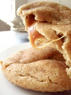 Caramel Stuffed Snickerdoodles recipe for a classic chewy cookie with a cinnamon sugar coating and to die for caramel filling. #snickerdoodle #cinnamoncookies #caramelcookies #cookierecipes #bakesale #partytreats