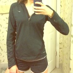 Black Nike Female Jacket This is a size small, black, reflective, running jacket. I'm a huge runner and this is one of my favorite running pieces. Long arms. Shorter torso so you can move much easier. I've worn this 4-5 times and it still looks brand new! Nike Tops Sweatshirts & Hoodies