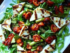 Grilled asparagus with roasted cherry tomatoes, haloumi, and arugula with a balsamic dressing. I want it now!