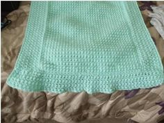 Stitch: Popcorn Stitch Using H/8 Hook  Material: 100% Acrylic Sport Weight Baby Yarn by Lion Brand in Mint Green  Selling Status: SOLD!   Dimensions: 38 in X 23 in