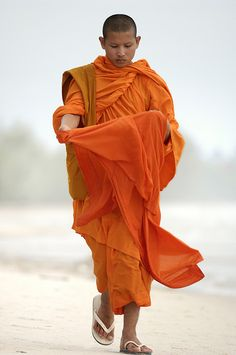 Sihanoukville by Arddu: Traditionally, monks' robes were dyed with spices turning them yellow or orange, hence 'saffron robe'. The cloth today is still dyed in spice colors. http://buddhism.about.com/od/thefirstbuddhists/ig/The-Buddha-s-Robe/Buddhist-monks-in-Laos.htm #Monk #Cambodia #Arddu