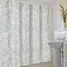 Features:  -Material: Cotton blend.  -Machine washable.  -Beaumont collection.  -Designer: Jennifer Adams.  -Light green and cream color, paisley swirl pattern.  Product Type: -Shower curtain.  Color:
