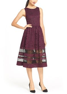 The lacy, contrasting sheer panels on this burgundy fit-and-flare number is an eclectic twist on a prim-and-proper burgundy midi dress.