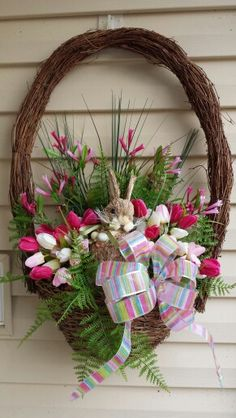 Easter/Spring hand crafted wreath .. egg shaped grapevines ... bunny amid tulips and ferns ...