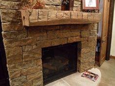 Timberline Framers Inc, Pagosa Springs, Colorado. Stone fireplace with a timber mantle.