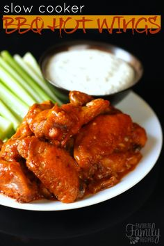 These Slow Cooker BBQ Hot Wings with Blue Cheese Dip are going to be a hit at your next party! They have way more flavor than your typical hot wings !