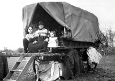 P DX263/2/34 35/14402: Gypsy caravan and family. Smiths camp Malvern Link, Worcestershire. 1939