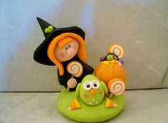 This little witch looks quite pleased with her haul of Halloween treats!