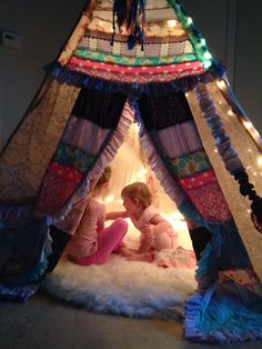 Boho Teepee with Faux Fur Rug - such a whimsical play space!