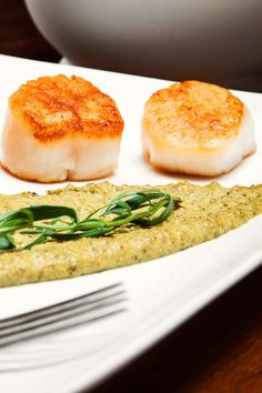 NYT Cooking: If you're looking for something to pair wonderfully with a few glasses of amber-hued amontillado, you can't do much better than these tender, burnished sea scallops, inspired by a memorable midcourse of scallops with pistachios and licorice at Restaurant Daniel. Though you're less likely to overcook larger sea scallops, remember that quality is more critical than sheer size. In the market, look...