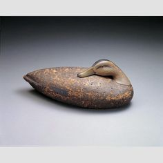 "BLACK DUCK/ Charles E. ""Shang"" Wheeler (1872–1949), Stratford, Connecticut, c. 1930, paint on wood and cork with glass, 5 7/8 × 16 × 6 3/4"", collection American Folk Art Museum, gift of Alastair B. Martin, 1969.1.15. Photo credit: John Parnell."