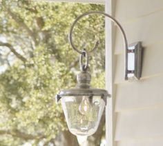 Though the photo is surprisingly blurring (why, Pottery Barn, why?), I LOVE this fixture. It'd be perfect on either side of our front door once the front porch is installed!