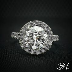 18 karat white gold engagement ring, featuring a stunning 2.75 carat round brilliant #diamonds that's surrounded by .65 carats of fine melee diamonds. #engagementring #diamondengagementring #customengagementring #bridalfashion #bridaljewelry #bridetobe #customjewelry #wedding #bride #jewelrydesign #customdesign #diamondring