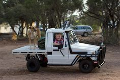 By Land -- One lucky chap: this little guy has his own mini Land Cruiser, and a dog on the back. Does this little guy have the best Dad in Australia? Whoever built his son this miniature ute must be an early contender for Father of the Year Landcruiser Ute, Landcruiser 79 Series, Pick Up, All Terrain Tyres, Power Wheels, Ride On Toys, Pedal Cars, Go Kart, Toyota Land Cruiser