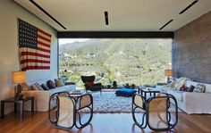 Thonet chairs in the Toro Canyon house's living room are placed to provide impressive vistas of the forest and mountains. By California architect, Barbara Bestor. Photo by John Ellis