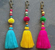 Items similar to Tassel Pom Pom Keychain Bag Charm - Zipper Pull - BOHO Chic - Wooden Beads - Pink Aqua Yellow tassels - Green Red Pompom on Etsy Pom Pom Crafts, Yarn Crafts, Sewing Crafts, Diy Keychain, Tassel Keychain, Diy Tassel, Tassels, Pom Pom Bag Charm, Boho Chic