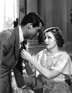 The Awful Truth. A wonderfully absurd 30s comedy. Cary Grant and Irene Dunne are lovely (and she has the most over-the-top clothes).