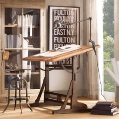 i love the look of this Drafting table, it looks old.  I could really use this in my office.