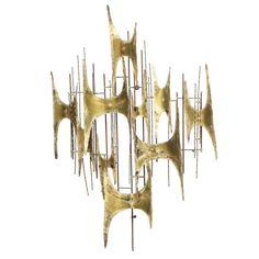 Brass Wall Sculpture by Curtis Jere, 1969 -- love the Niemeyer influence