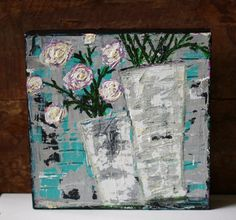 Blossoms is an original, heavily textured painting using thick acrylic paint. The background is comprised of collaged papers which were then