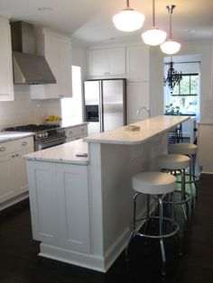 DIY white kitchen with marble and schoolhouse lights