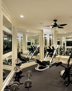 200 sq ft mirrored home gym w/ built-in TV and rubber floor