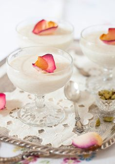 Almond-Rice Cream Pudding ground rice milk pinch of salt g) sugar ground blanched almonds rosewater ½tsp ground cardamom rose petals for garnish, optional Just Desserts, Delicious Desserts, Dessert Recipes, Yummy Food, Creamy Rice Pudding, Panna Cotta, Indian Sweets, Cupcakes, Indian Food Recipes