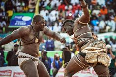 Emeu Sene (on the left) hits Balla Gaye 2 (on the right) during a fight in the stadium of Demba Diop on April 5, 2015.