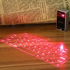 Cientos de articulos con descuento y envio gratis Magic Cube Laser Projection Virtual Bluetooth Keyboard… Ahorra con tus marcas preferidas