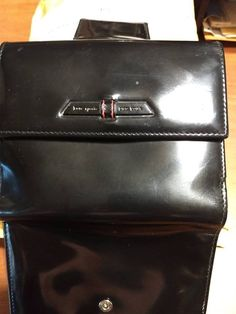 b7e3500dc14c Kate Spade Wallet black Patent leather in good condition with red lining