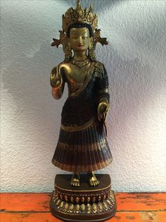 Standing bronze/copper Buddha. Rare position. Nepal. 19th cent.