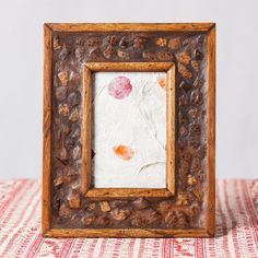 Pieces of coconut shell give this frame its tropical look.