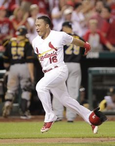 Kolten Wong tosses his helmet as he approaches home plate after hitting a walk off home run in the ninth inning against the Pirates. Cards won 5-4. 7-08-14