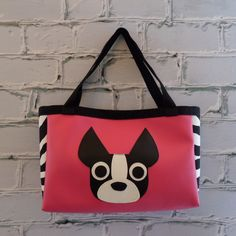 "Adorable vinyl tote with shoulder strapsFabric Side Panels and Interior with pocketwith Boston Terrier Face14"" Wide   10"" High    3"" DeepPlease choose your vinyl color and side panel/interior fabric from the drop down menu!"