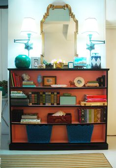 how to place items on bookshelves for decorative purposes: Jenny Komenda.